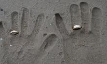 Handprints in sand