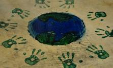 Handprints around a globe