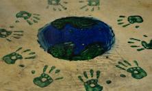Handprints around a globe