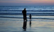 Photo of father & child on beach