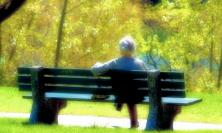 Photo of woman on bench by Grant MacDonald at flickr.com