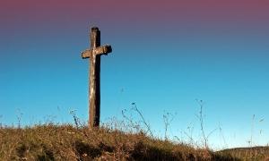 Cross standing on hill