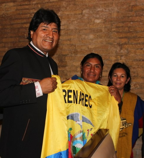 Evo Morales greets fellow delegates at the WMPM